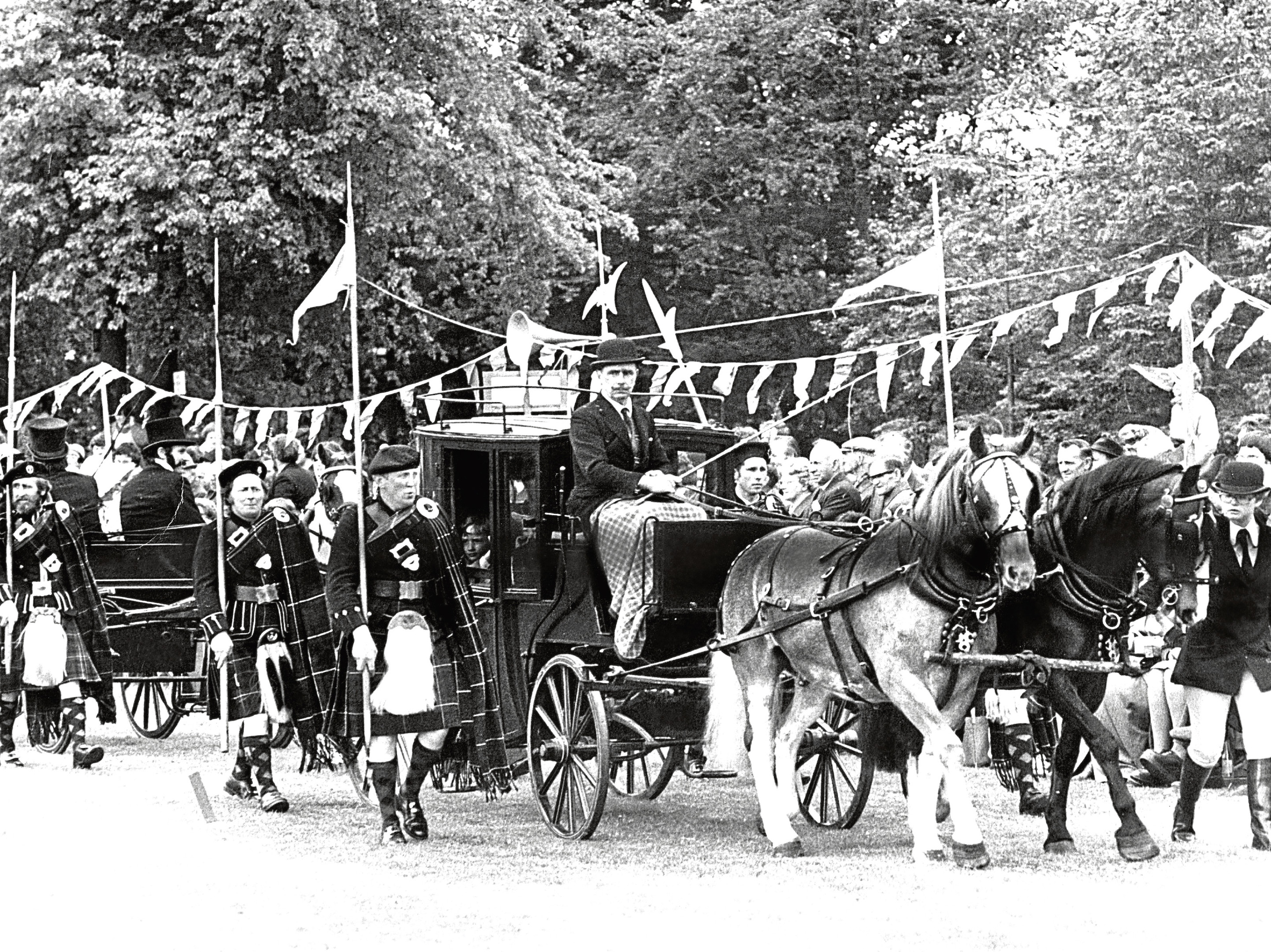 A Victorian procession was held with Lonach Highlanders flanking coachman John Taylor, of Dyce, in 1977.