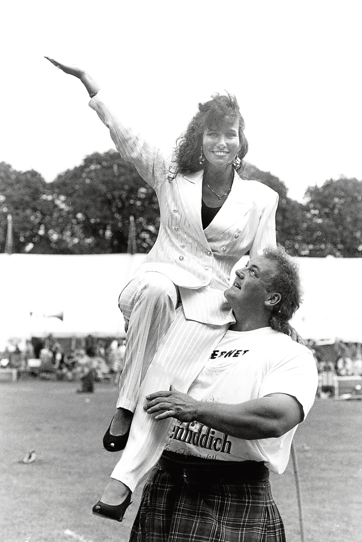 Linda Lusardi gets a lift from Peterhead heavyweight Francis Brebner after she opened the Games.