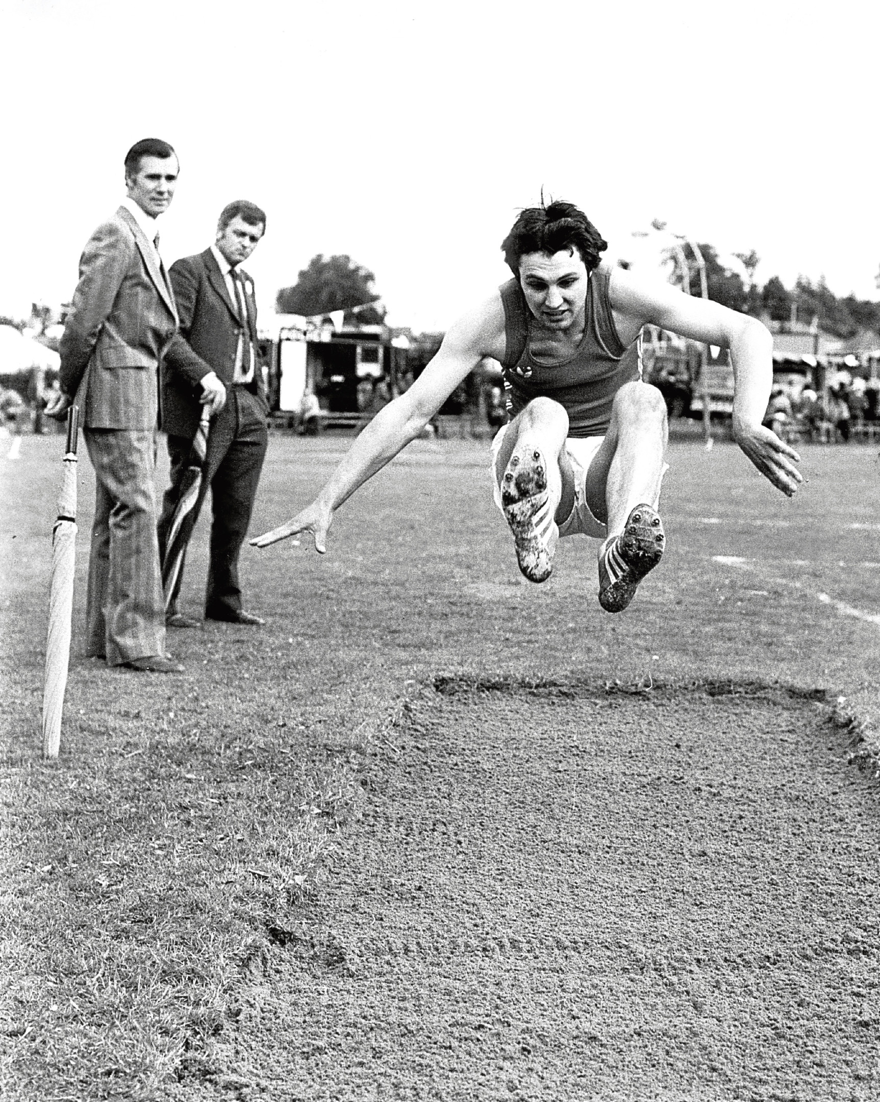 Derek Reid from Insch flies though the air in his attempt at the long jump.