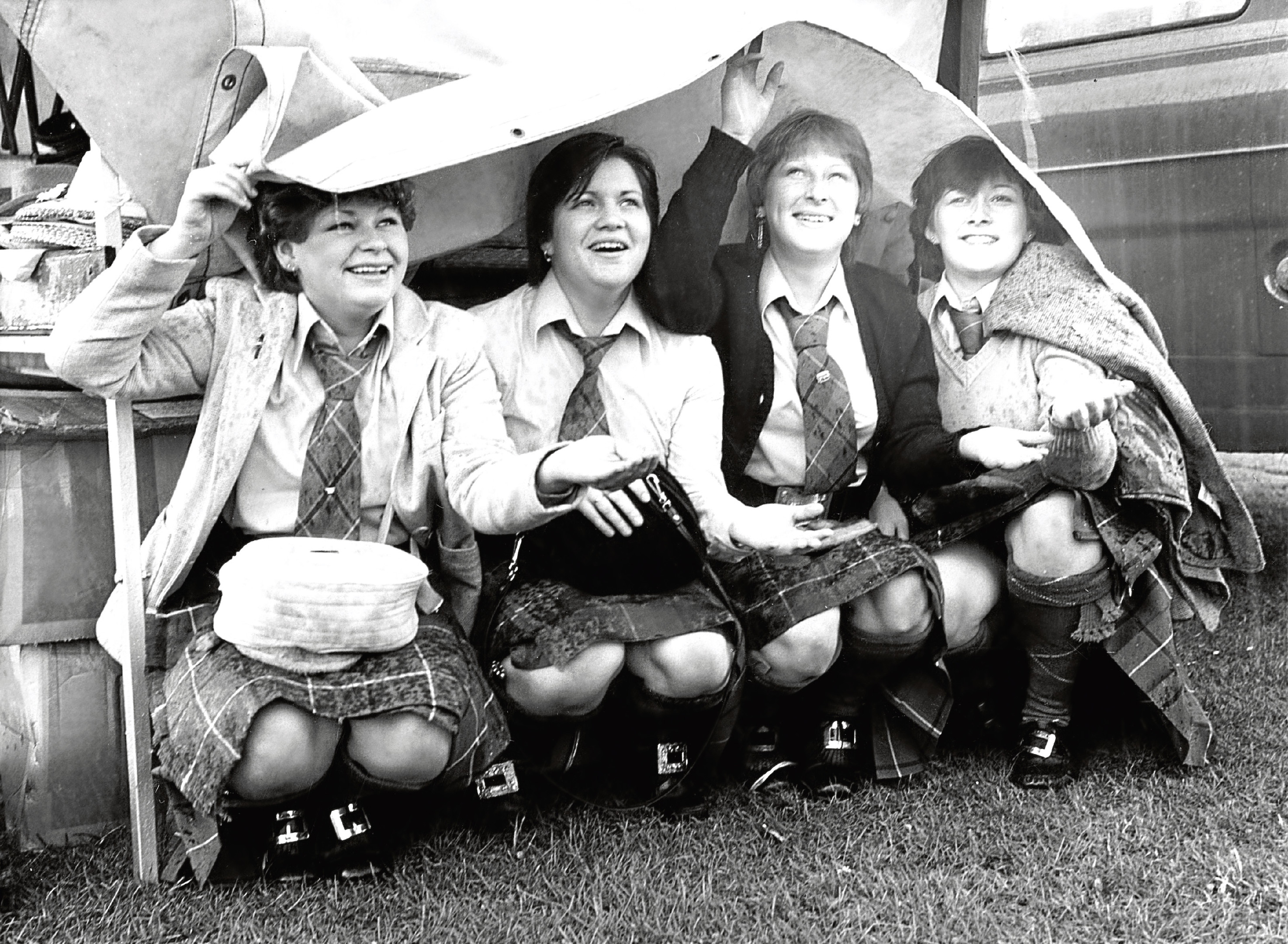 Florence Simpson, Morag Murray, Rosanne Stevenson and Janice Milne of Deeside Ladies Pipe Band take cover.