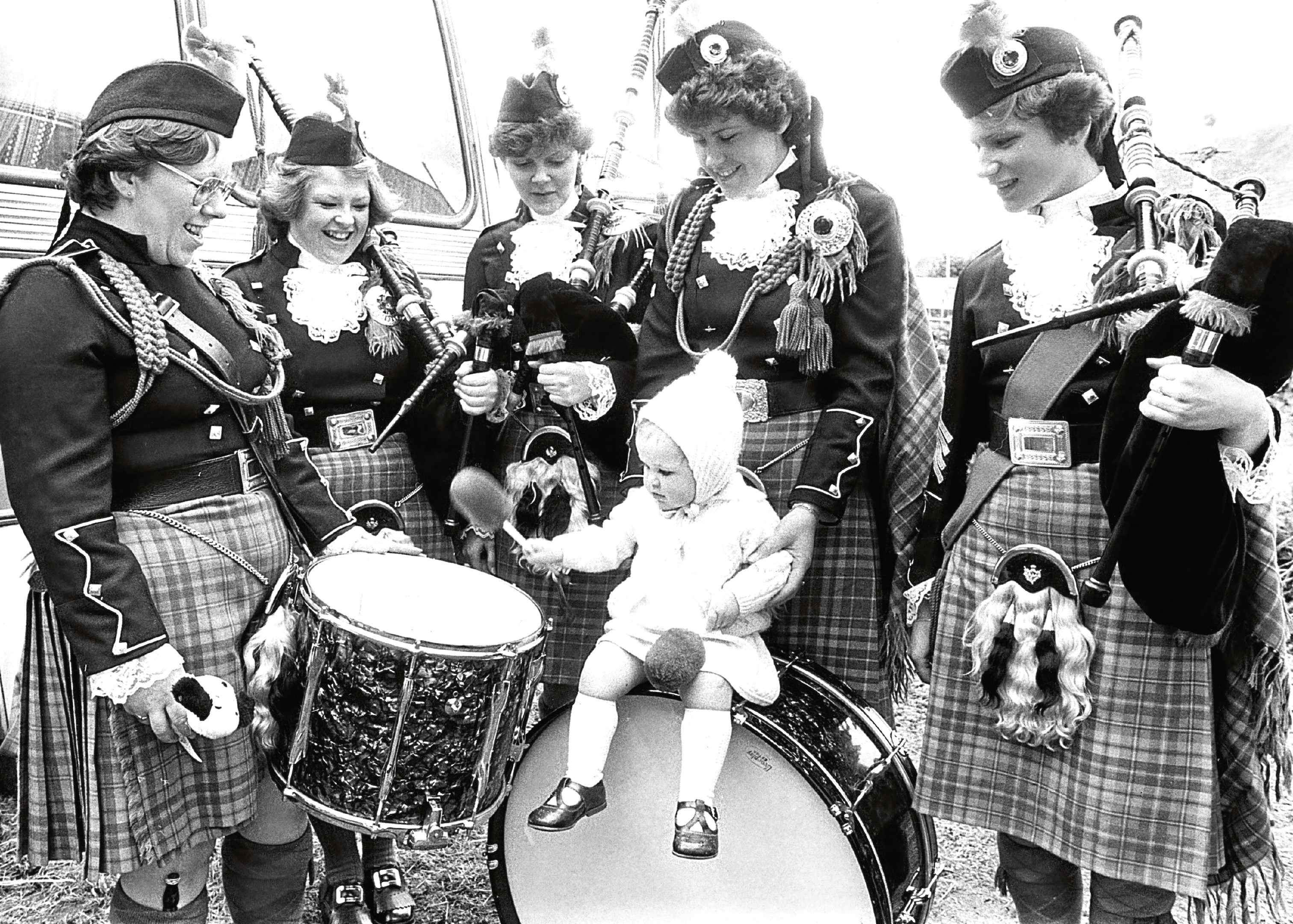 Bon Accord Ladies Pipe Band are joined by 18-month-old Wendy Carle as she plays the drums.