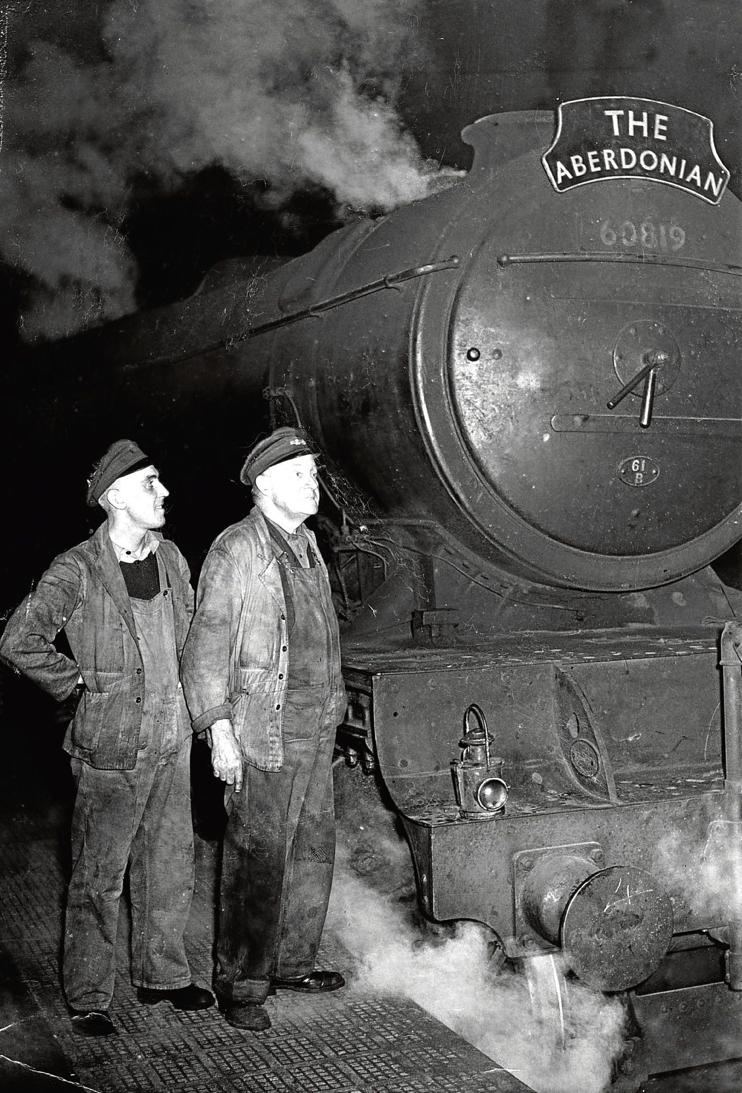 Engine driver James Russell and fireman Peter Womble chat before taking a trip.