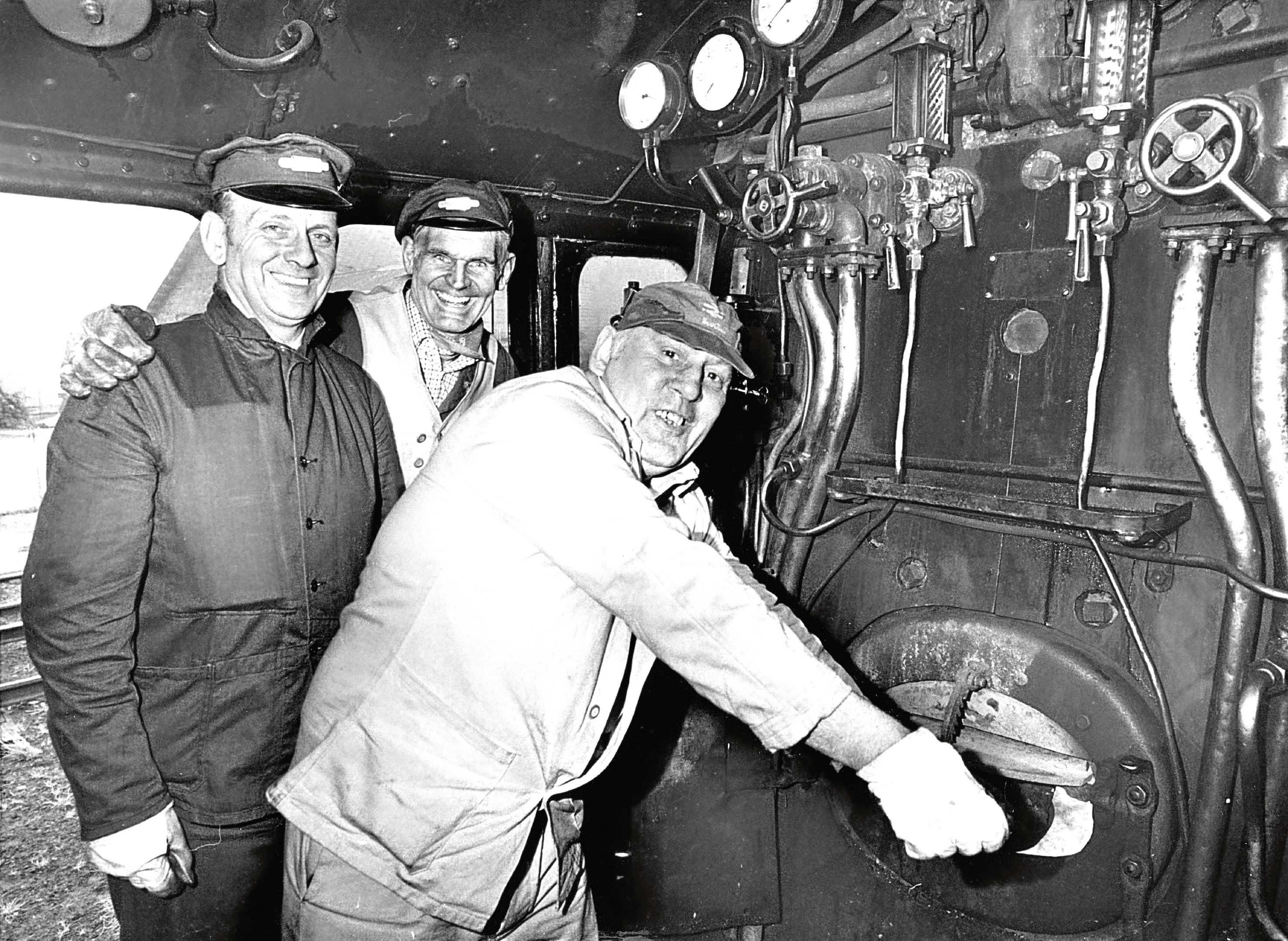 Stoking the boiler of A4 Pacific locomotive Osprey is fireman Danny Kennedy with driver Jimmy Edward, left, while John Cameron, centre, owner and ScotRail chairman.