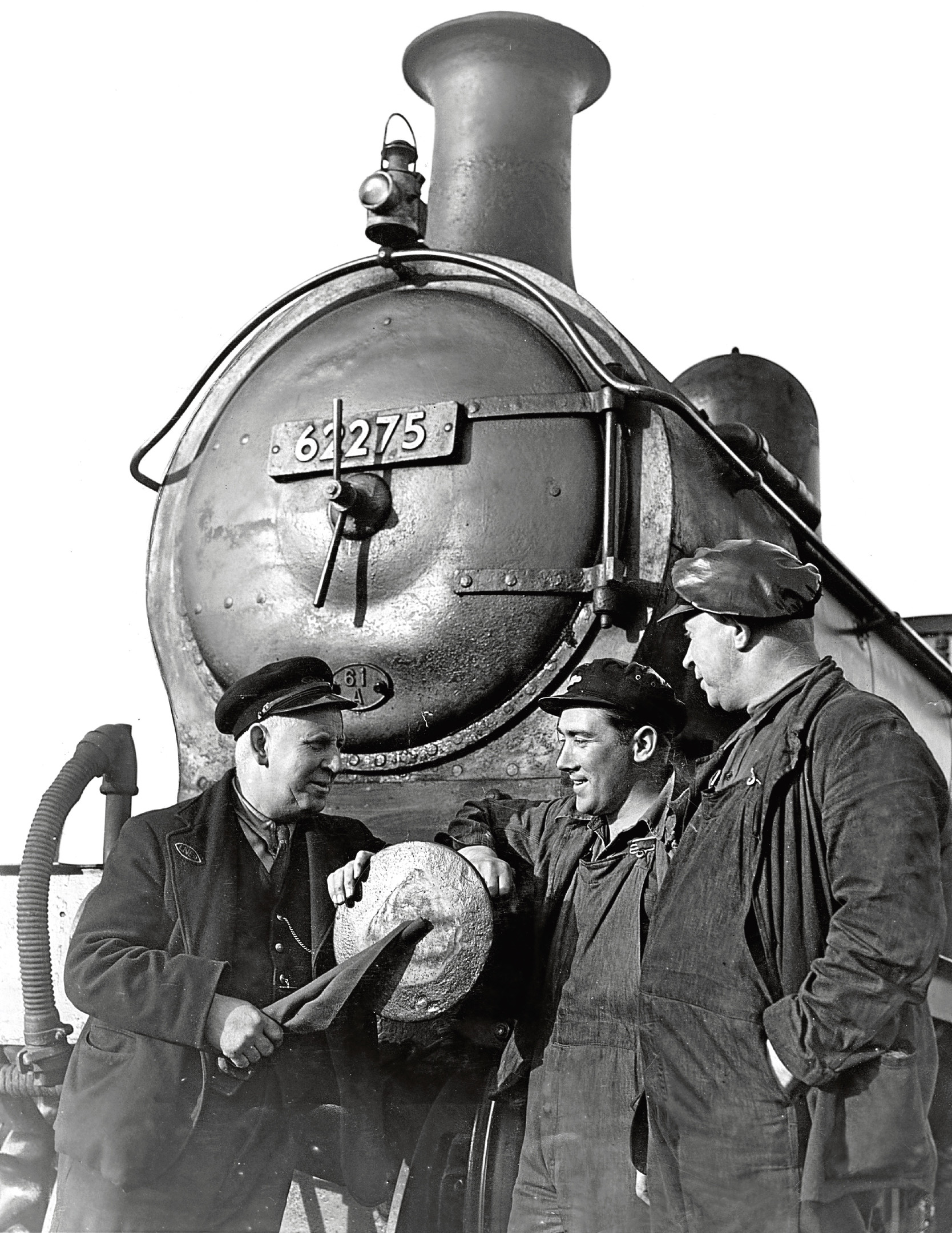 Sir David Stewart, the last engine to pull the Macduff to Inveramsay train out, waits for, from left, guard James Milne, fireman William Rumbles and driver John Cowie to finish their chat before heading off.
