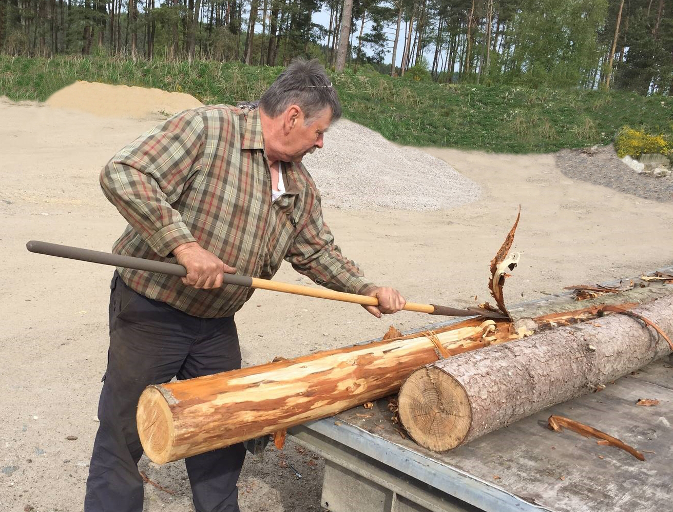 Murray Brown strips the bark from the new Aboyne games caber.