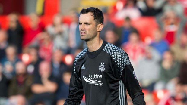 Aberdeen goalkeeper Joe Lewis saved a penalty against Hibs at Pittodrie.