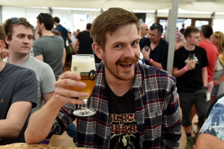 One of Scotland's biggest beer festivals, Midsummer Beer Happening 2017, at Baird Park, Stonehaven. Picture of Kieran Beattie enjoying a drink.  Picture by KENNY ELRICK     17/06/2017