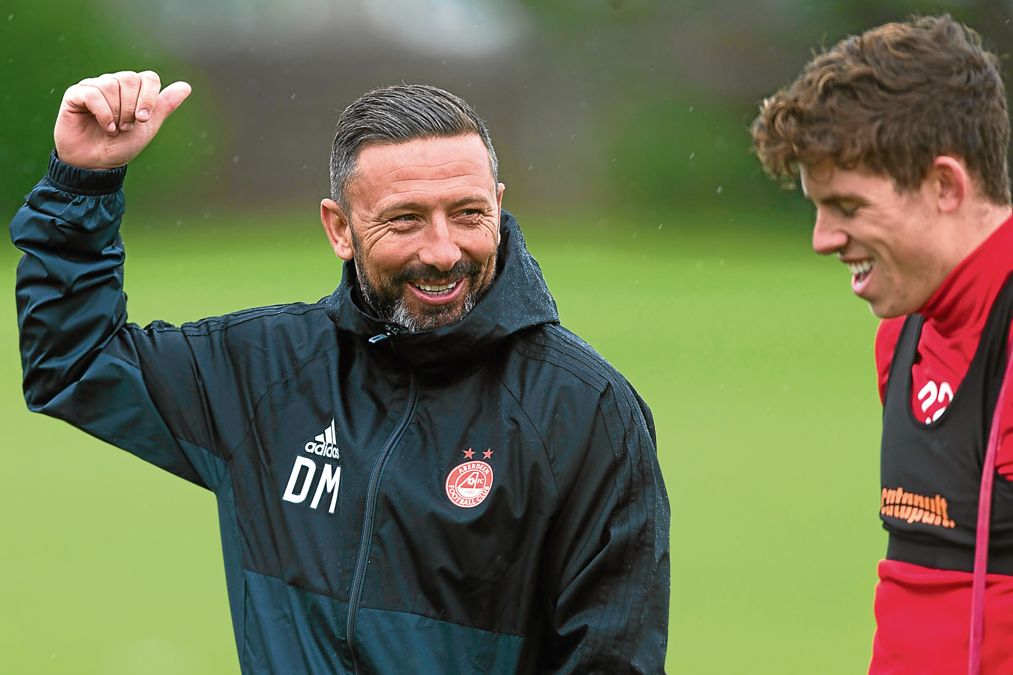 Dons boss Derek McInnes with Ryan Christie.