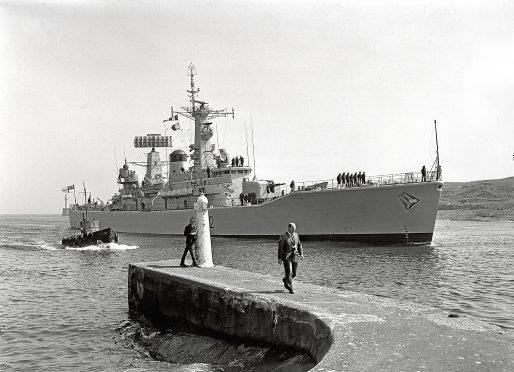 1967: HMS Phoebe, a Leander-class frigate, entering Aberdeen Harbour in 1967.