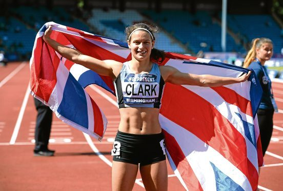 Zoey Clarke celebrates winning the Womens 400m Final during the British Athletics World Championships Team Trials at Birmingham Alexander Stadium in Birmingham, England.