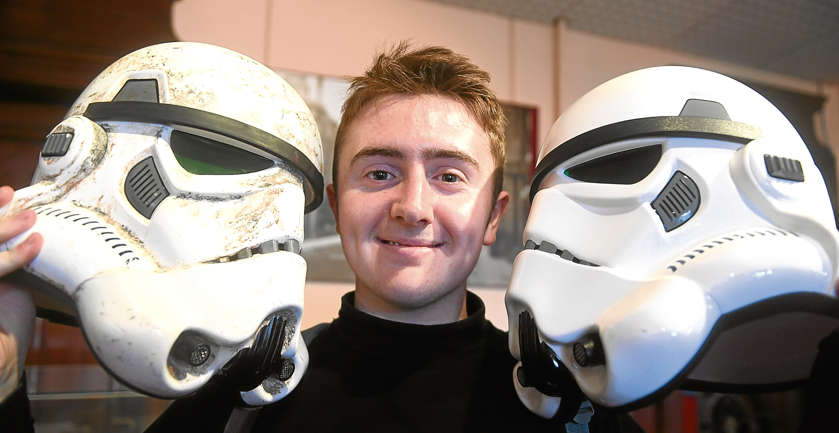 Andrew Stephen with two Stormtrooper helmets.