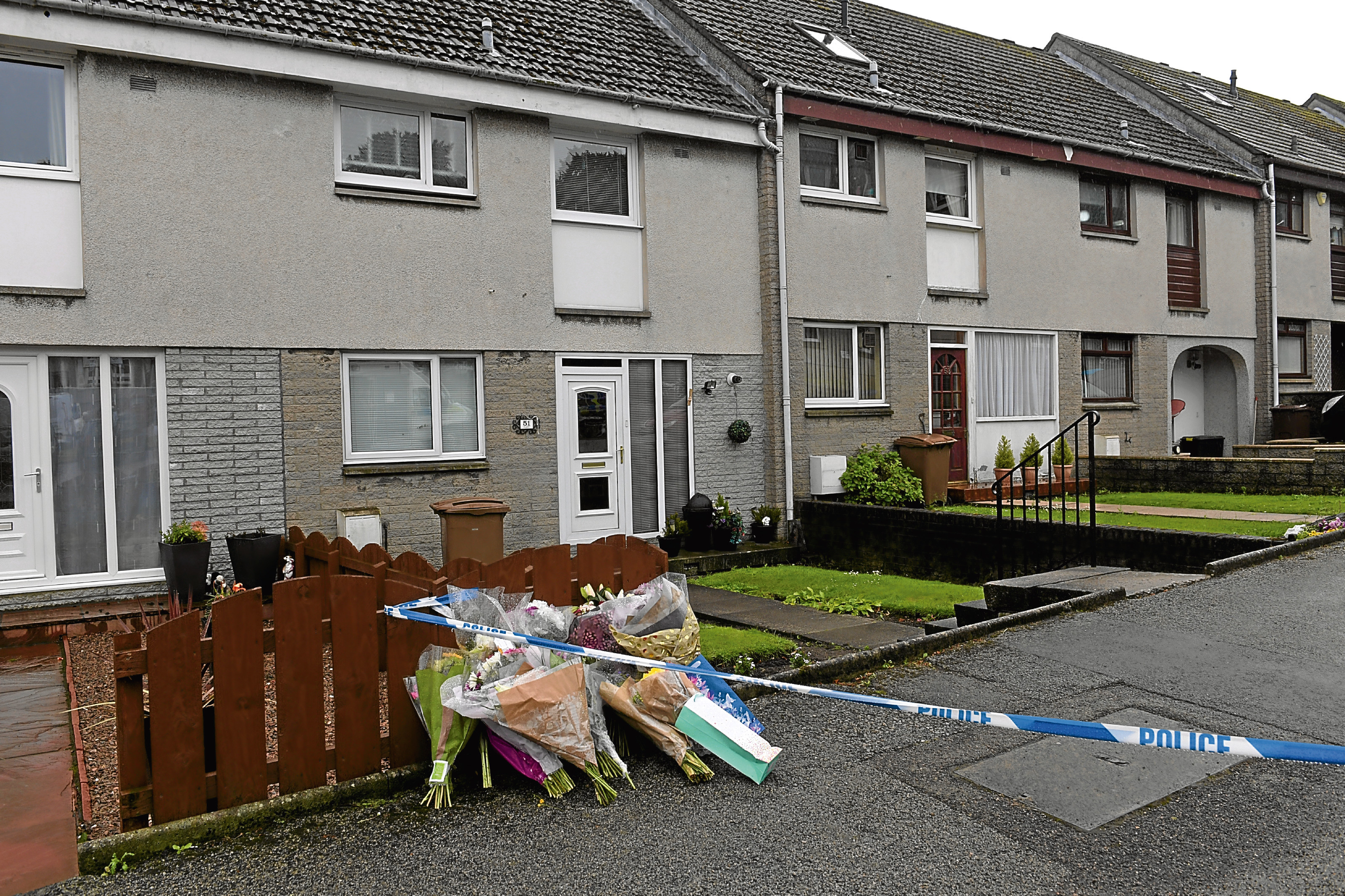 Floral tributes outside the house in Cornhill Terrace where two people died last week