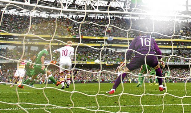 Shaun Maloney scores against the Republic of Ireland for Scotland.