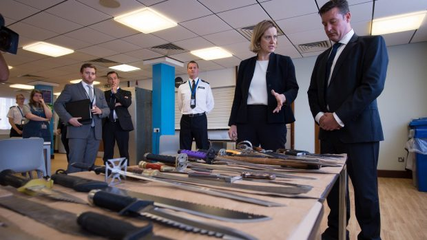 Home Secretary Amber Rudd is shown a collection of knives by Superintendent Sean Yates that have been involved in knife crime and recovered by the police in London