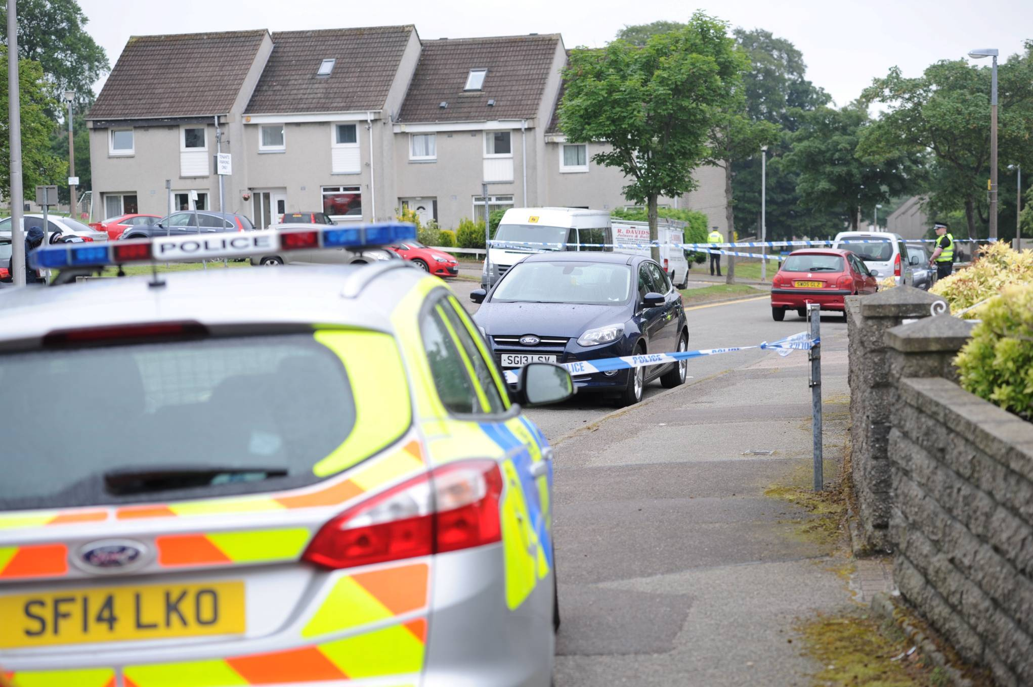 Police sealed off roads around the property in Aberdeen's Cornhill Terrace after the bodies of a man and woman were found