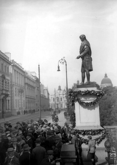 A gathering in the 1920s, presumably for Burns Night, around the famous statue of Robert Burns in Union Terrace.