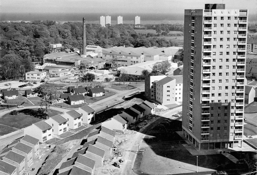 1971: A dramatic view of Donside Paper Mills, Aberdeen, with the new housing scheme at Hayton/Tillydrone going up in the foreground, with four skyscrapers at Seaton in the distance.
