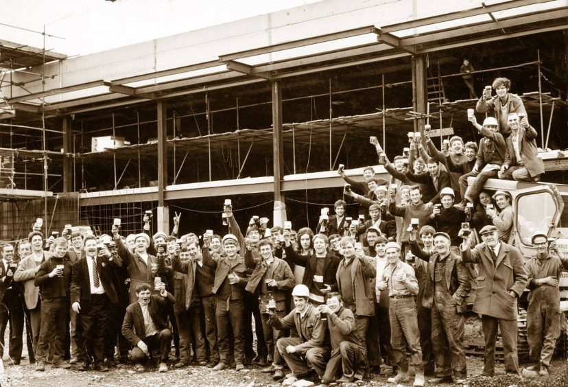 1970: Builders raise their glasses to celebrate the topping out of the new Fine Fare store at Aberdeen's Bridge of Dee in 1970. The store was built on the site of the old greyhound stadium and is now a base for Asda.