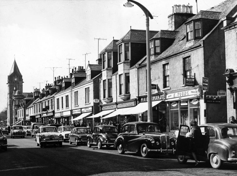 1966: Cars line Banchory's High Street and shoppers throng the pavement in April 1966. At the time it was claimed that Banchory had one of the healthiest economies in Scotland.
