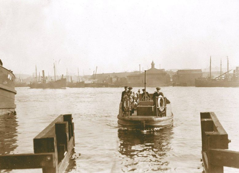 An Aberdeen Harbour ferry in operation around 1910 between Torry and the Footdee area.