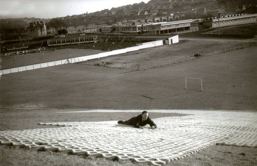 The new dry ski slope at Kaimhill was being laid in 1967, with the greyhound racing track and the Dee Motel in the background.