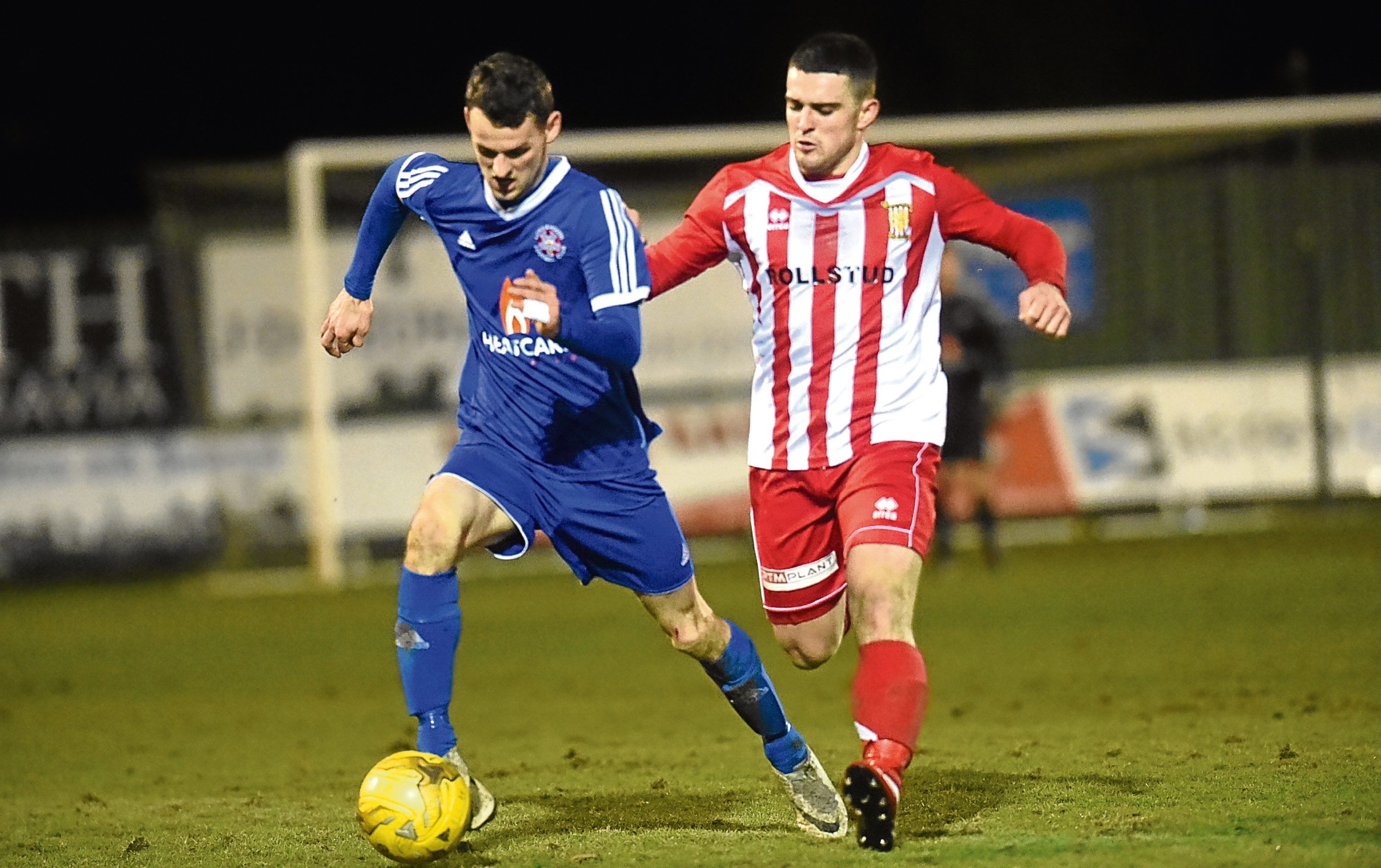 Formartine V Lossie (blue) at North Lodge Park, Pitmedden.  Pictured are Lossie's Ryan Farquhar and Formartine's Scott Barbour.  15/03/17  Picture by HEATHER FOWLIE