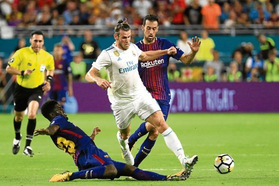 MIAMI GARDENS, FL - JULY 29:  Samuel Umtiti #23 of Barcelona defends against Gareth Bale #11 of Real Madrid in the first half during their International Champions Cup 2017 match at Hard Rock Stadium on July 29, 2017 in Miami Gardens, Florida.  (Photo by Mike Ehrmann/Getty Images)