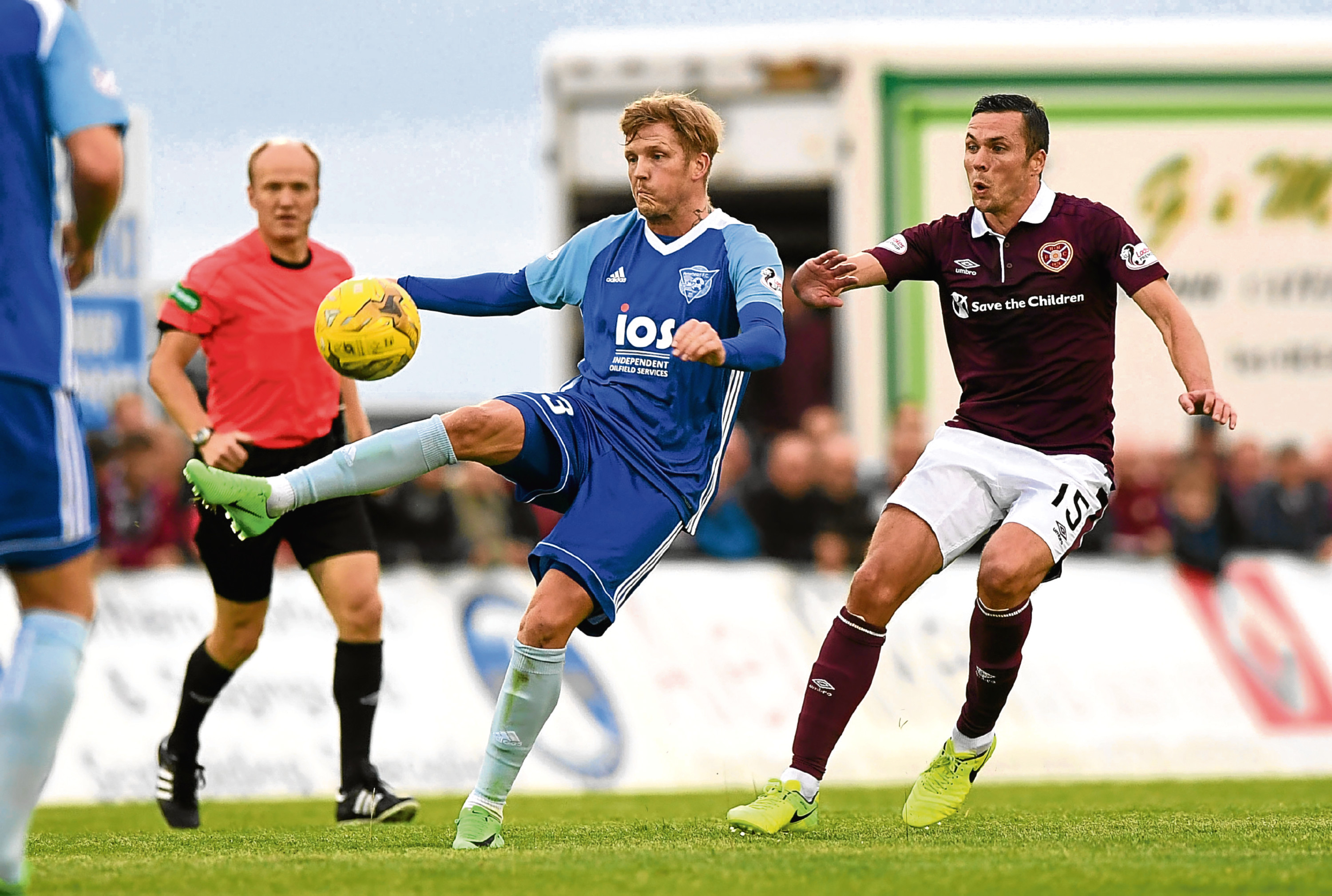 25/07/17 BETFRED CUP  PETERHEAD V HEARTS  BALMOOR STADIUM - PETERHEAD  Peterhead's Willie Gibson holds off Hearts' Don Cowie