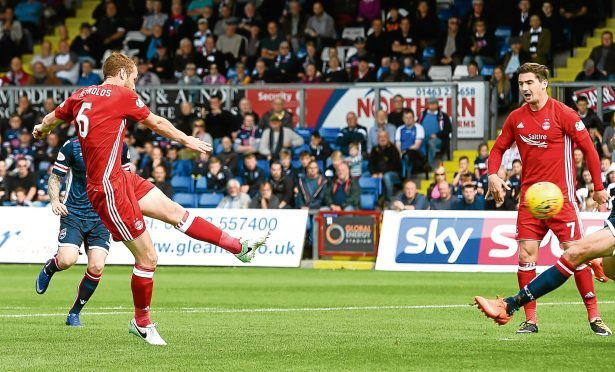 Aberdeen's Mark Reynolds scores.