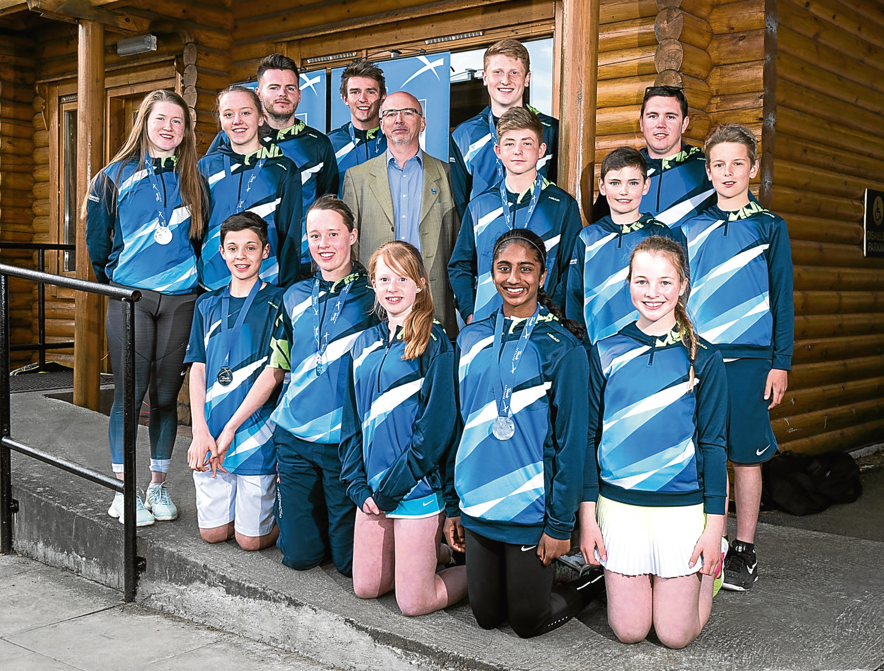 The North-east Scotland Lawn Tennis Association inter-district team,. Pictured in the middle is Andrew Hawke, president of Tennis Scotland,  and team captain Matthew Kerswell, pictured back right.