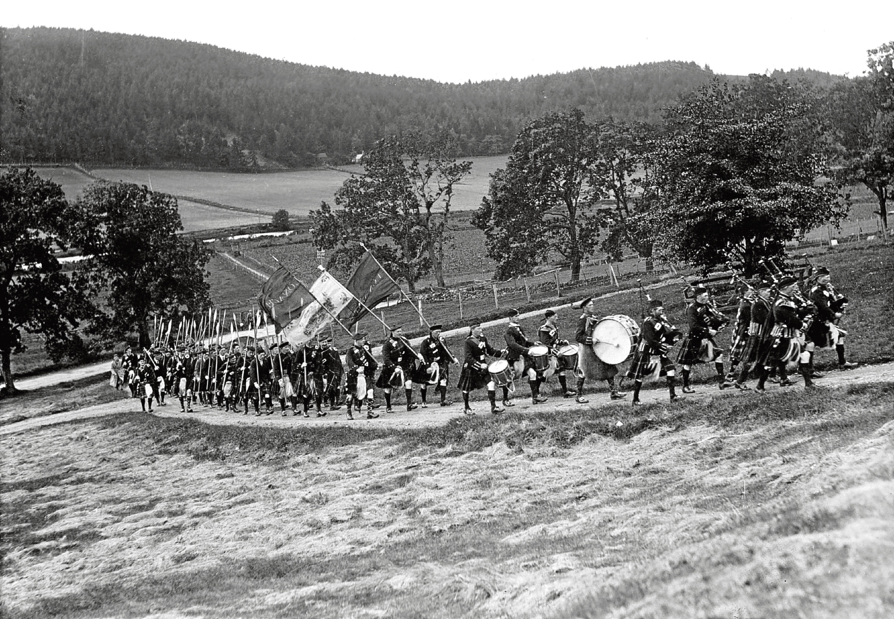 1930s:  The march of the clansmen at Lonach is a stirring sight.