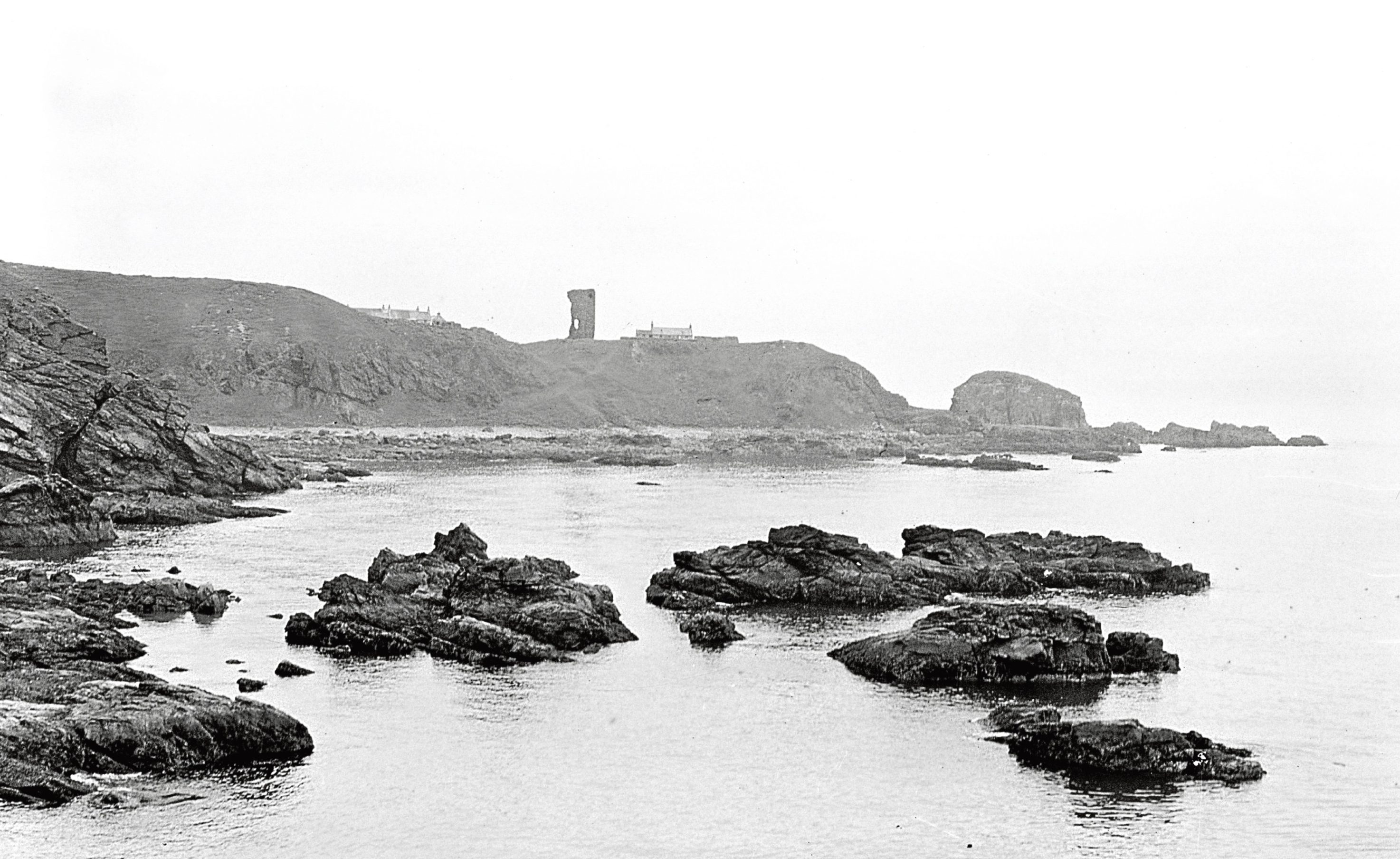 1939: An atmospheric view of Old Slains Castle and the Scaurs of Cruden.