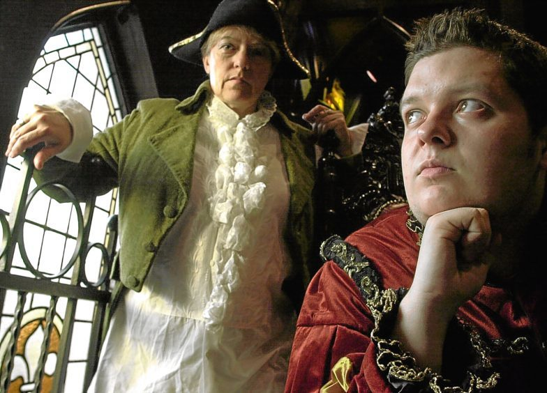 2003: Actors Laura Leonard ( as an Edinburgh citizen) and Steven Harrison (Lord Darnley) rehearse the play Scottish Times at Slains Castle.