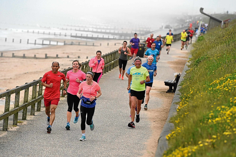 Runners along Aberdeen Beach