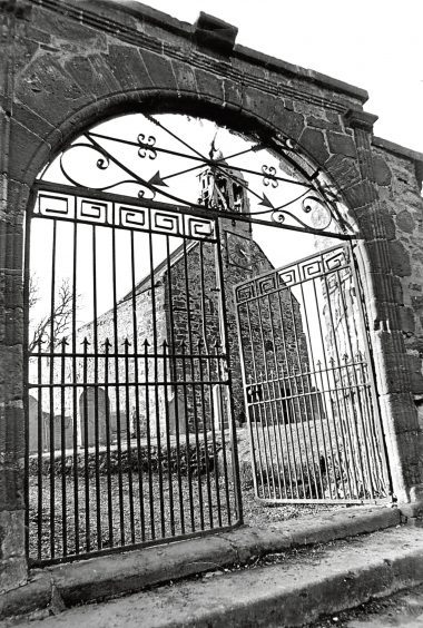 1976: The picturesque gateway to the Old Kirk of Turriff, with its double bellcote.