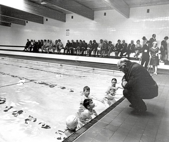 1973: Maitland Mackie talks to four young swimmers at the opening of Turriff swimming pool.
