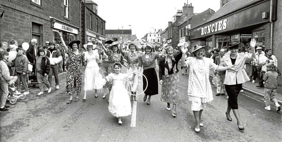1990: Maitland's of Turriff fashion models taking over the main street in the town as they parade before taking part in their show in the department
