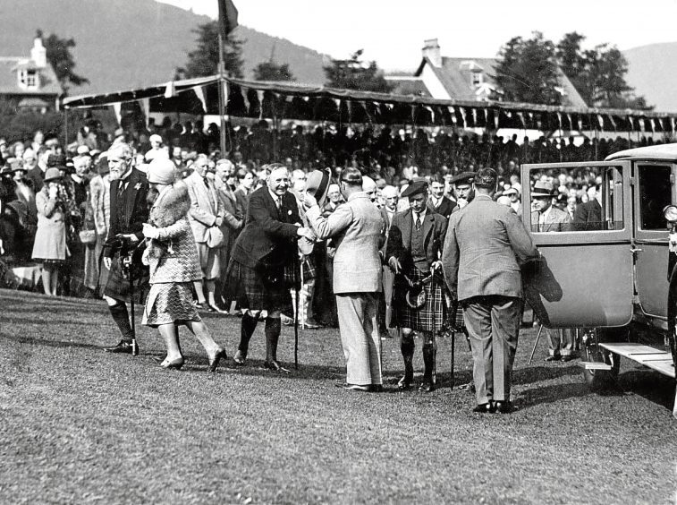 1929: The Duke and Duchess of York arrive at the Gathering with the Duke of Gloucester.