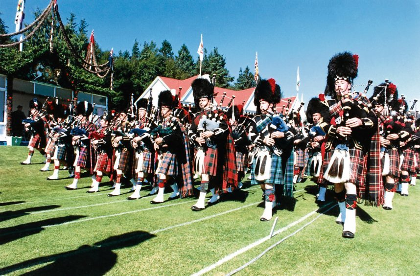 1991: The spectacular massed pipe bands march past the Royal Pavilion.