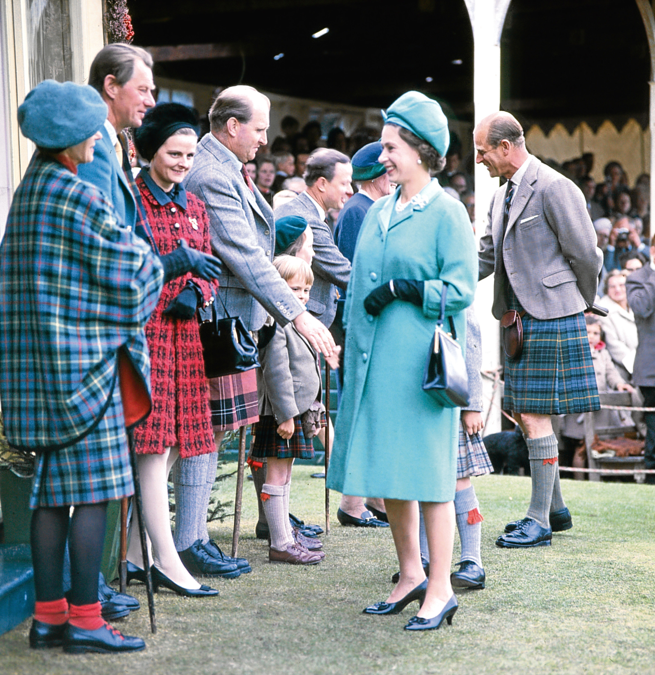 1969: The Royal party are greeted by guests at the Royal Pavilion at the Gathering.
