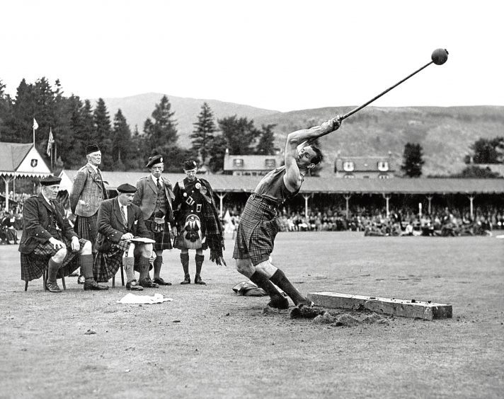 1948: The judges watching a hammer thrower in action at the Braemar Gathering.