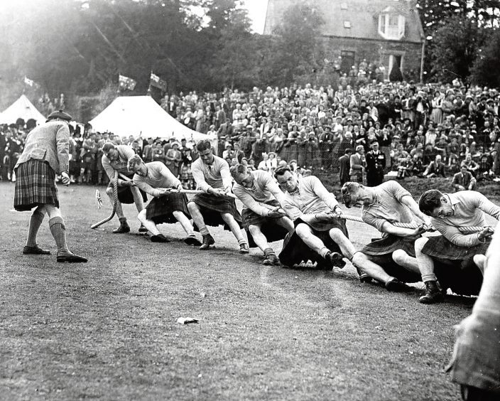 1956: The Cameron Highlanders' Colonel in Chief watches the Gordons win the tug-of-war.