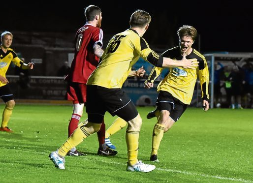 Sam Burnett celebrates after scoring his second to make it 2-0.