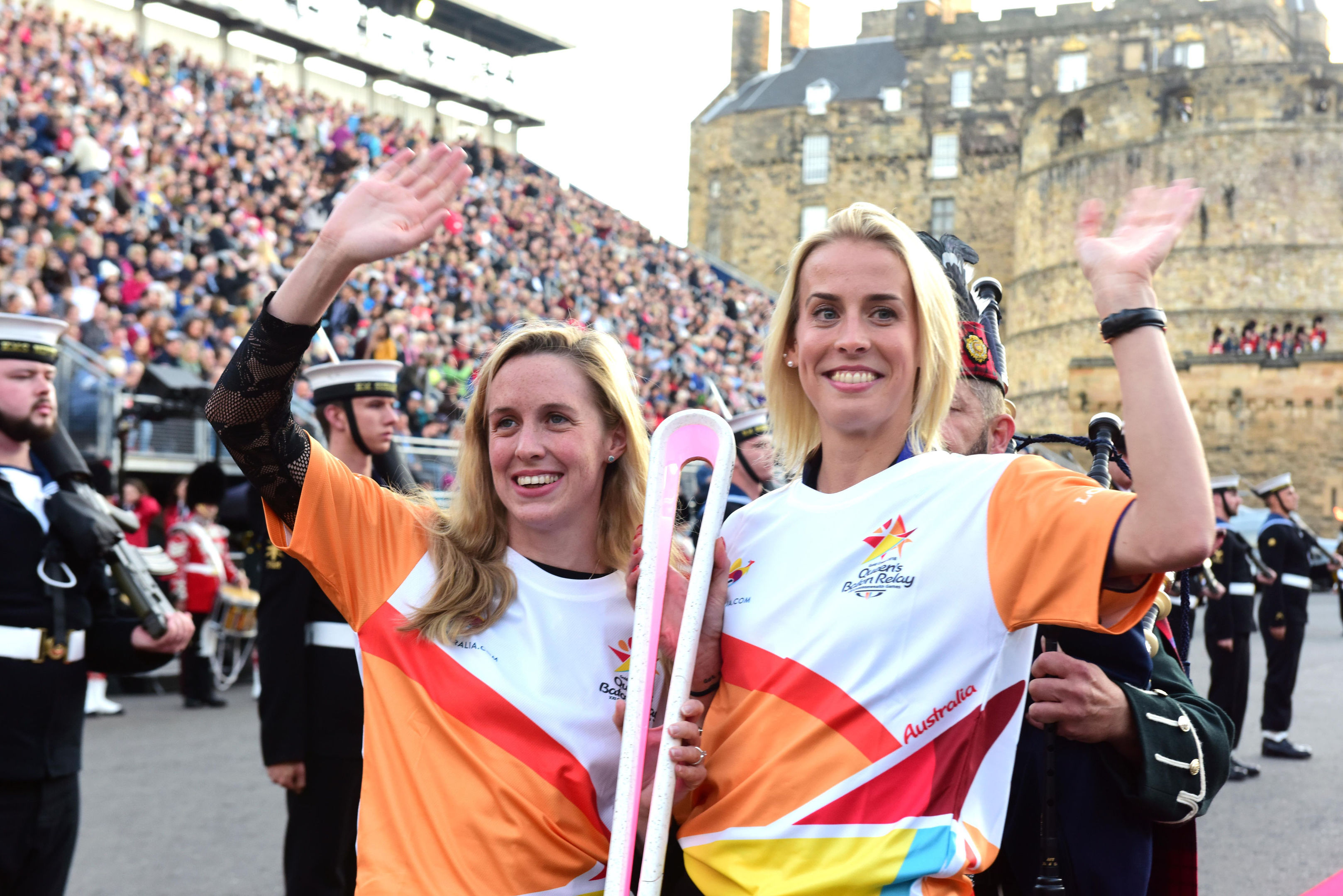 Hannah Miley (left) and Lynsey Sharp with the Gold Coast 2018 Queen's Baton.