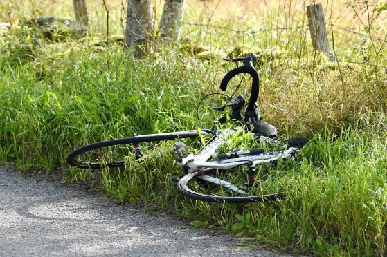 The man's bike lies at the side of the South Deeside Road