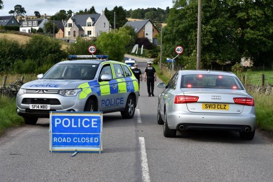 Police at the scene of the crash on the B976 South Deeside Road
