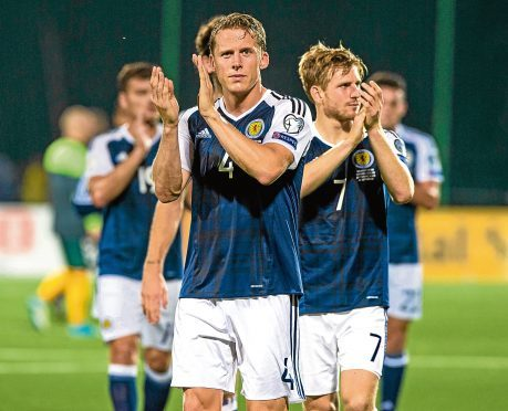 Scotland's Christophe Berra applauds the fans at full time.