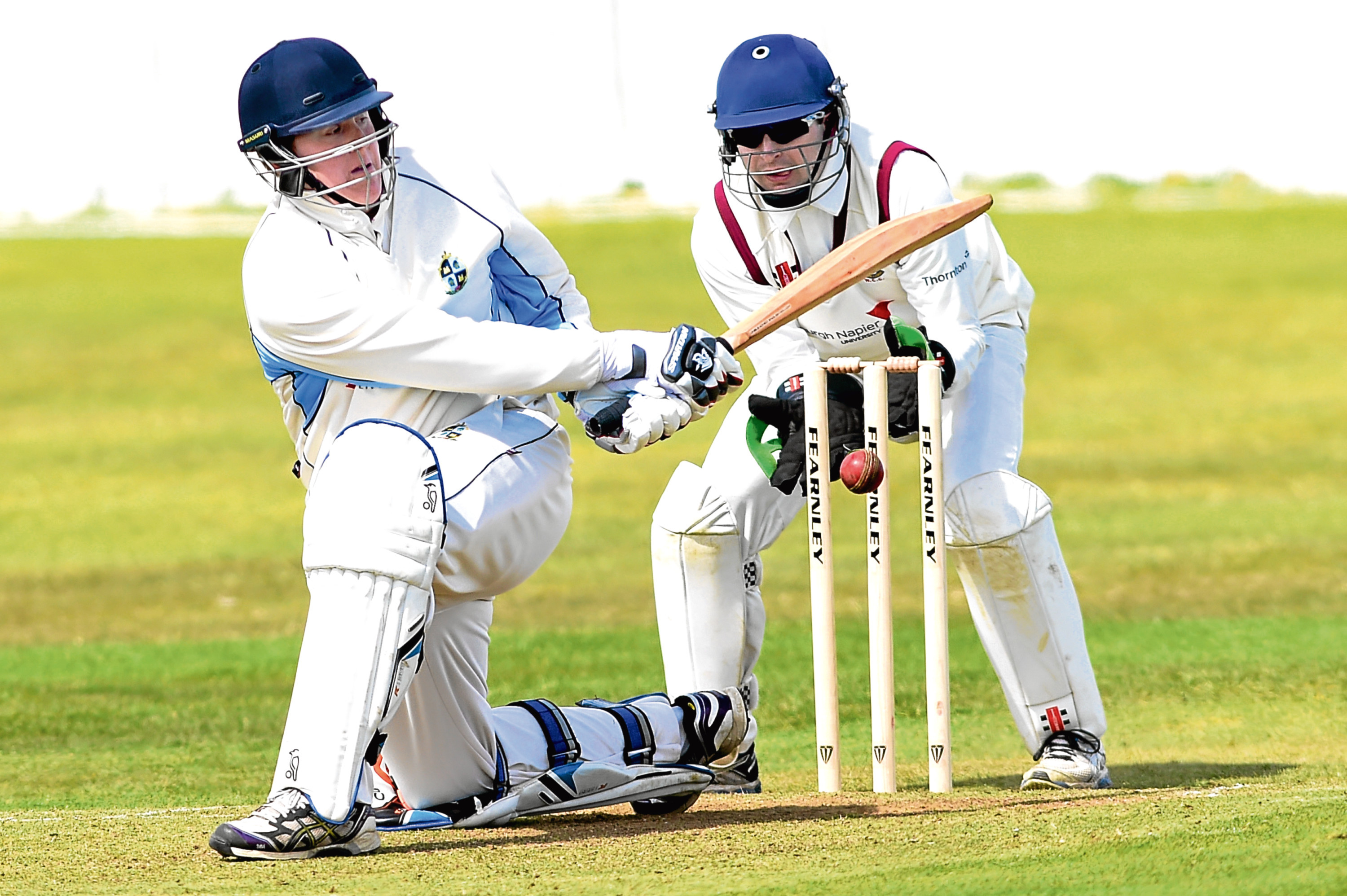 Stoneywood's Jack Mitchell batting with Watsonians wicket keeper Andy Heslop.