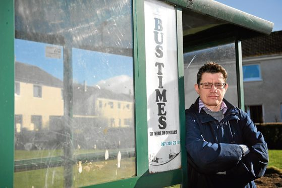Councillor Aaron McLean beside a bus stop in Forres. He is angry that some services are to be withdrawn by Stagecoach.  Picture by Gordon Lennox 01/03/2017
