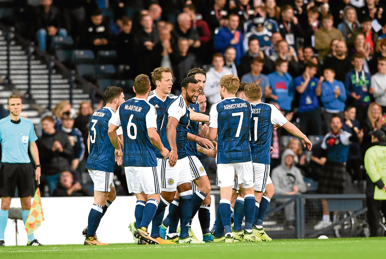Scotland players celebrating Christophe Berra scoring to put Scotland 1-0 ahead against Malta.